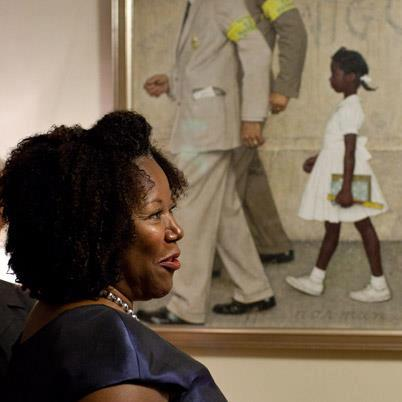 ... Norman Rockwell painting of Ruby Bridges with Ms. Bridges posing